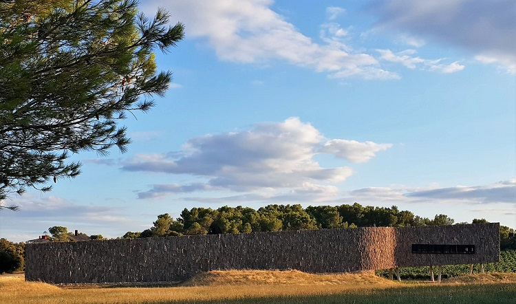 The bottle-shaped cork-clad Castigno winery blending into the landscape