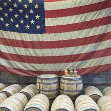 US flag and Tennessee whiskey barrels