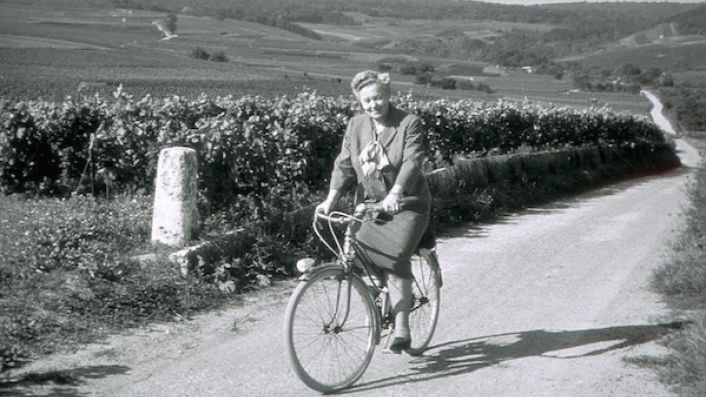 Madame Lily Bollinger on a bike in the vineyards