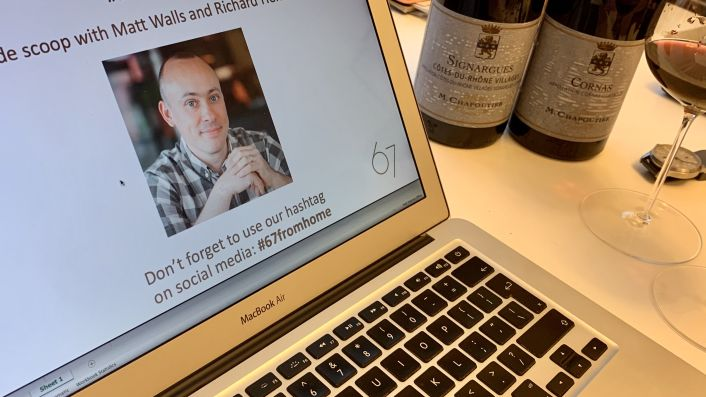 Laptop and wine bottles ready for an online wine tasting