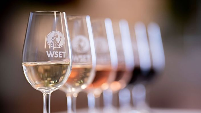 Wine in glasses embossed with the logo of the Wine & Spirit Education Trust