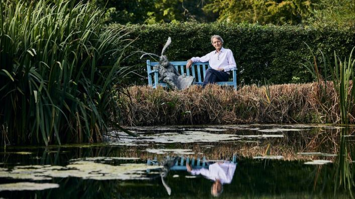 Steven Spurrier by a pond at home in Dorset