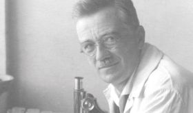 Cropped version of the Professor Zweigelt portrait in his lab