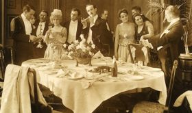 old sepia photograph of dinner party