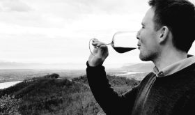 Jonathan Reeve sips Hermitage Rouge on the hill of Hermitage high above the river Rhône