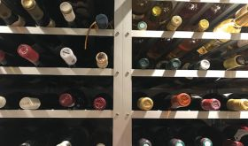 Bottles of wine on racks in a cellar