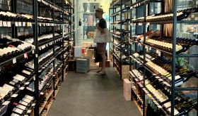 Richard Hemming choosing wine in Singapore