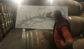 Jean-Luc Jamet in his cellar with a map of Côte Rôtie