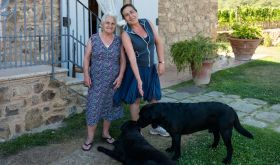 Laura Brunelli of Montalcino and her dog Orso, each with their mother